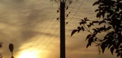 Щъркелово гнездо на залез